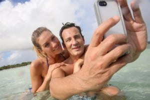 couple swimming taking a selfie